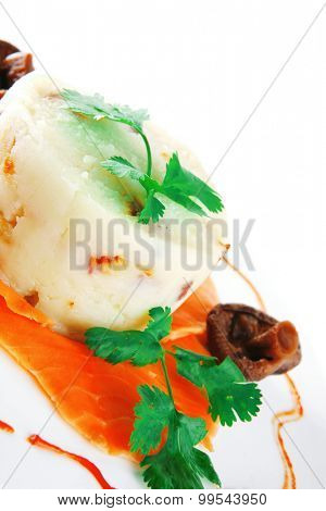 smoked salmon served with mashed potatoes on white