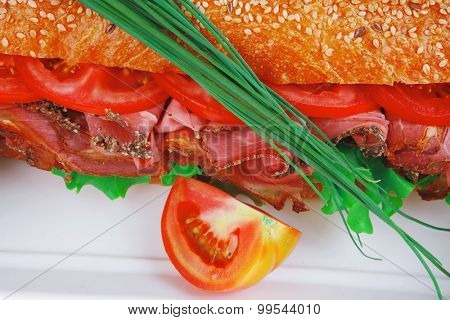 sandwich : fresh white french baguette with chicken smoked sausage isolated on white background