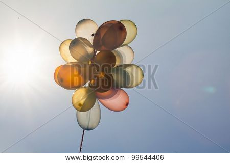 Colorful balloons on blue sky. Concept of love in summer, valentine, wedding and honeymoon