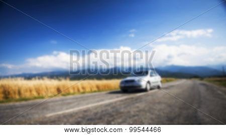 Blurred background with car on road