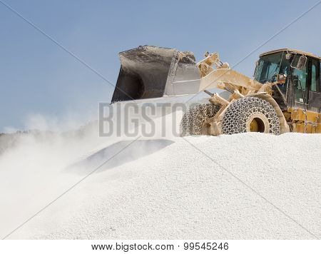 Bulldozer Working At Marble Quarry