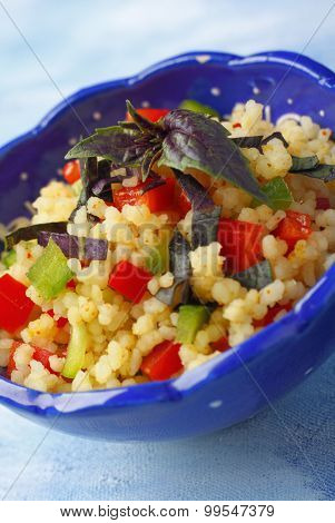Bowl With Couscous, Chopped Peppers And Red Basil