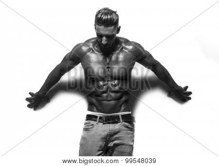 fitness male bodybuilder wearing jeans on white