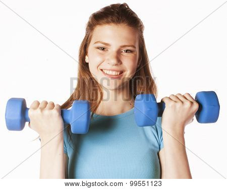 young pretty slim woman with dumbbell isolated cheerful smiling, girl next door