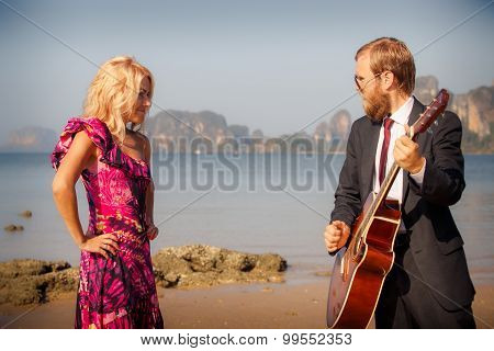 Blonde And Guitarist Side-view On Beach