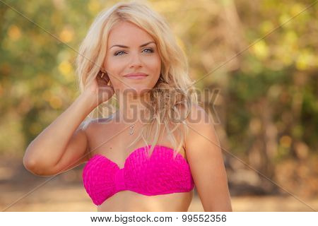 Blonde Girl In Pink Swimming Suit