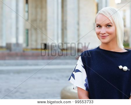 young blond woman walking on the street