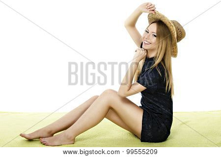 young woman in dress sitting down on a blanket