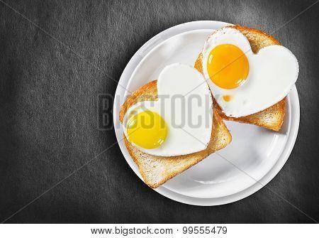Two Heart-shaped Fried Eggs And Fried Toast