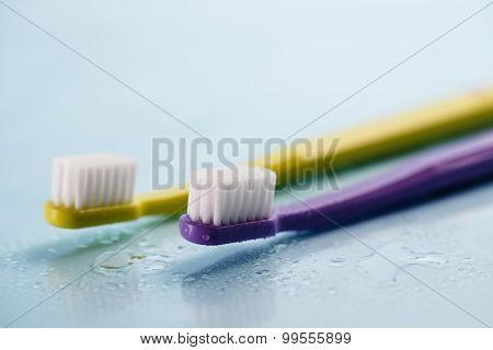 Toothbrushes on wet surface