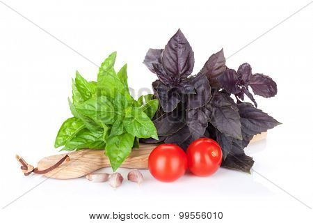 Fresh garden basil and cherry tomatoes. Isolated on white background