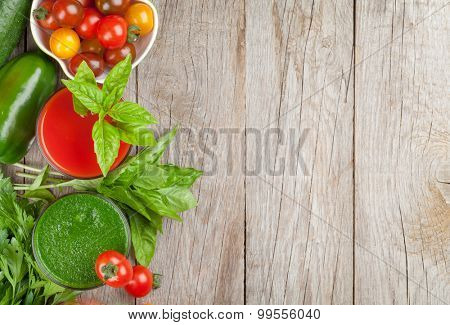 Fresh vegetable smoothie on wooden table. Tomato and cucumber. Top view with copy space