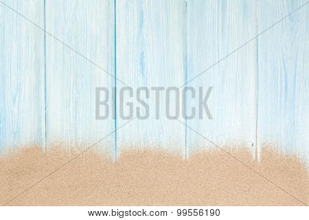 Sea sand on wooden floor. Top view with copy space
