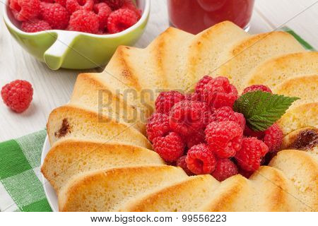 Raspberry cake, smoothie and berries on wooden table