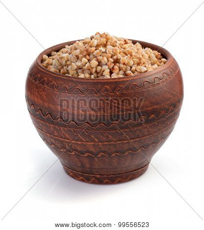 buckwheat in pot isolated on white background