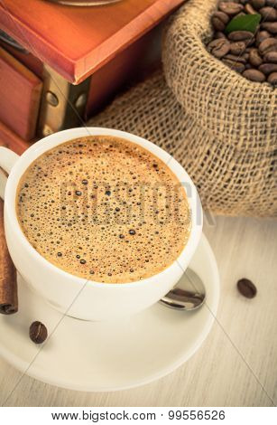 cup of coffee on wooden background