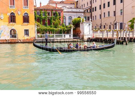 Venice. The Boat Trip Tourists In Gondolas.