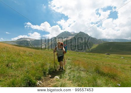 man with backpack in mountain