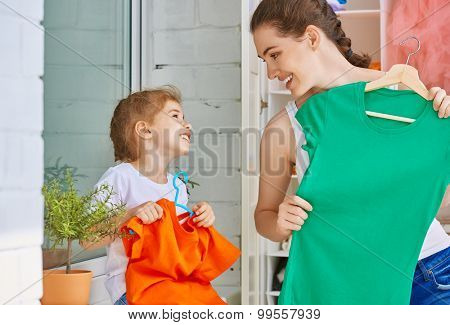 a family is trying on clothes