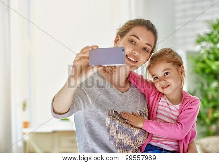 mother and daughter making a selfie