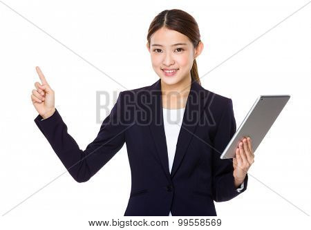 Asian young businesswoman hold with tablet pc and finger point up