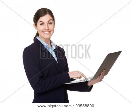 Brunette young businesswoman use of the notebook computer