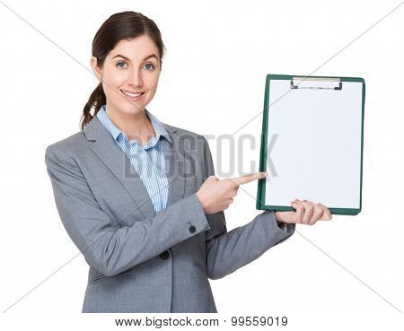 Young businesswoman finger point to blank page of clipboard
