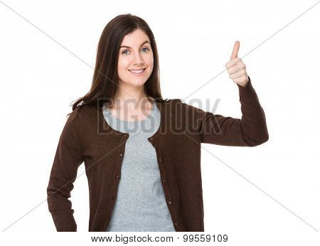 Brunette young woman with thumb up gesture