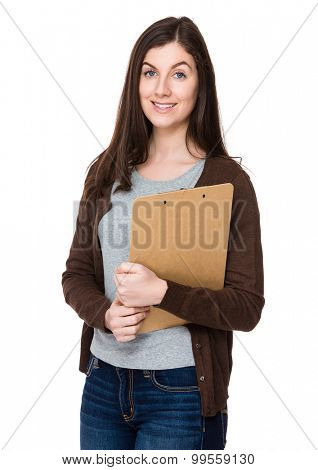 Brunette young woman hold with clipboard