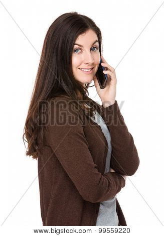 Brunette woman chatting via mobile phone