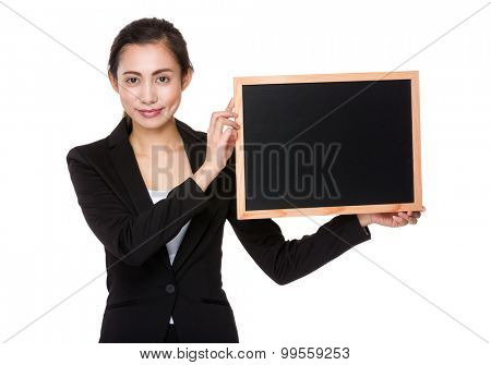 Young businesswoman show with the empty blackboard
