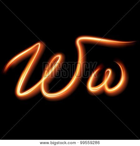 Glowing light letter W. Hand lighting painting