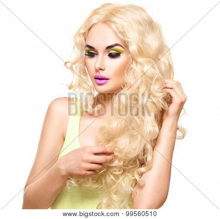 Curly hair. Glamour lady, Beauty Girl touching her Healthy Long Curly Hair. Blonde Woman Portrait. Blond Wavy permed Hair, perfect make up, smoky eyes. Isolated on white background