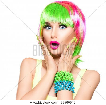 Surprised Beauty Fashion Model Girl with Colorful Dyed Hair, nails. Haircut with fringe. Colourful short Hair. Portrait of Beautiful Girl with Dyed Hair, professional hair Coloring. Colouring hair