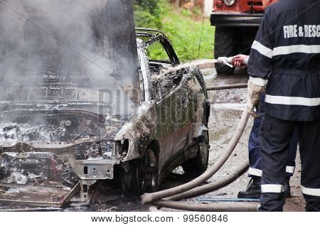 Burning Car. Totally burned car firefighter action.