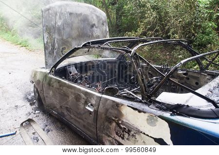 Burning Car. Totally burned car action.