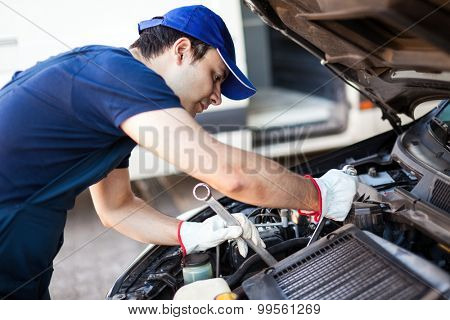 Mechanic repairing a car engine