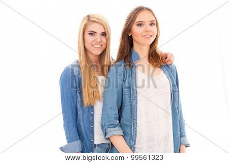 Young beautiful female friends on white background
