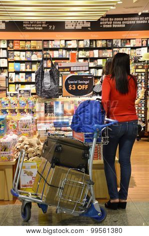 Customers Shop For Books In Changi Airport, Singapore.