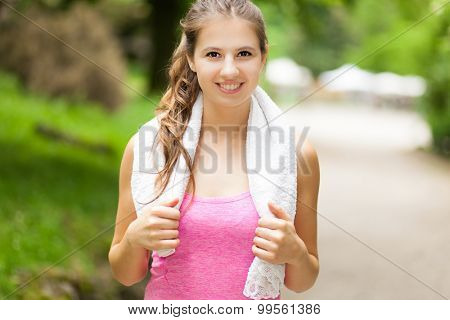 Active woman doing fitness in a park