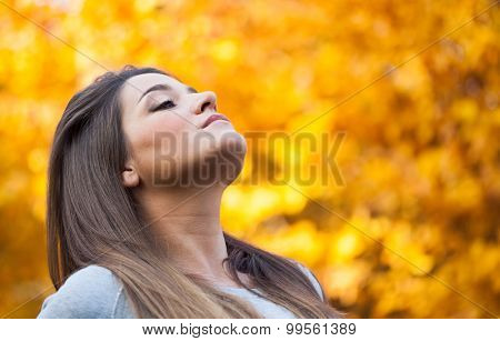 Portrait of a woman relaxing outdoor during autumn