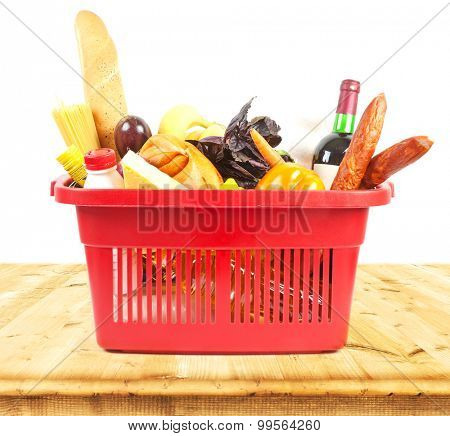 Basket with products on wooden table