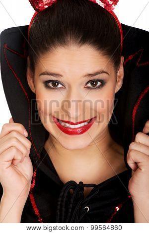 Beautiful woman in devil carnival costume.