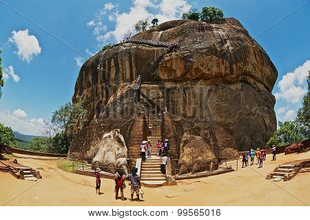 Tourists climb Sigiriya Lion rock fortress in Sigiriya, Sri Lanka.