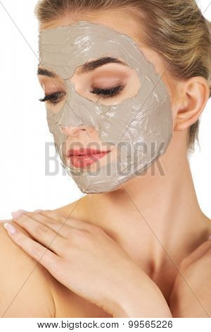 Young  woman with facial mask,isolated on white.