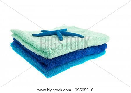 Blue stacked towels with starfish isolated over white background