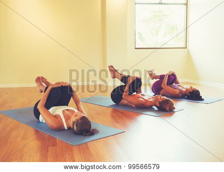 Group of Women Stretching and Relaxing in Yoga Class. Wellness and Healthy Lifestyle.