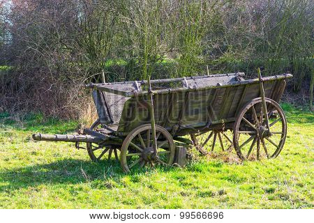 old wooden cart standing in the sun