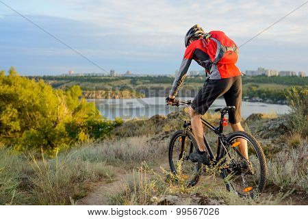 Cyclist Riding the Bike on the Beautiful Spring Mountain Trail. Sport Lifestyle Concept.