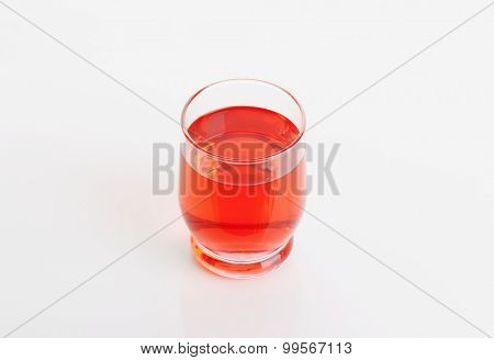 glass of strawberry juice on white background
